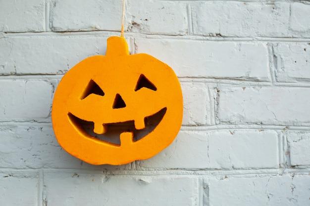 Halloween pumpkin close up on the brick wall background
