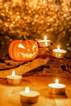 Halloween pumpkin decorate with candles on wooden timber