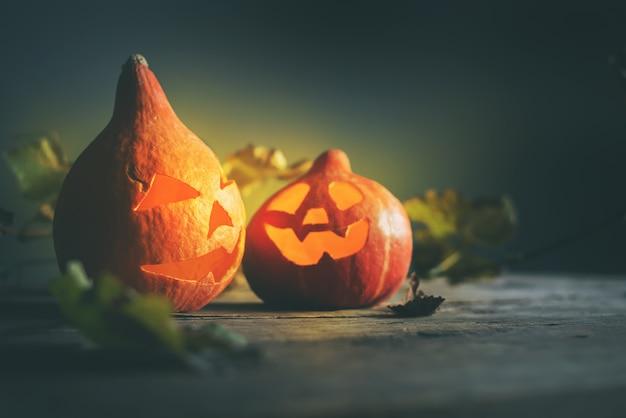 Halloween pumpkin head jack leaves wooden