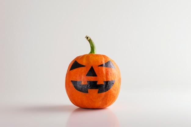 Halloween pumpkin head jack o lantern with smile isolated on white.