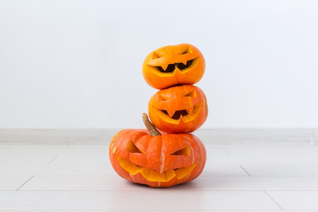 Halloween pumpkin heads jack lantern with scary evil faces