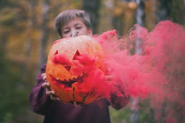 Halloween pumpkin jack o lantern decor with scary faces.