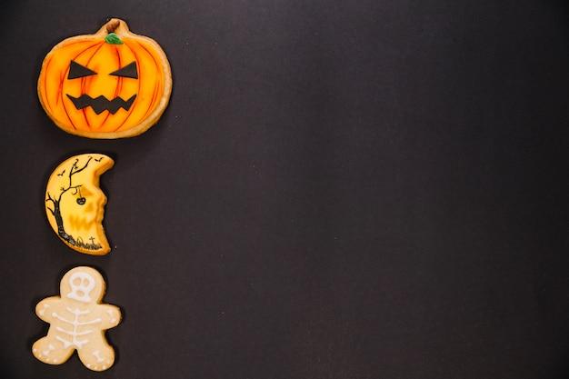 Halloween pumpkin, moon and skeleton cookies