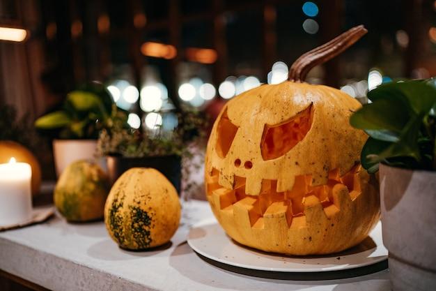 Halloween pumpkin at the table