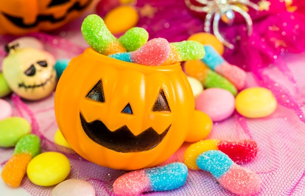 Halloween pumpkin, trick or treat with sweet candy