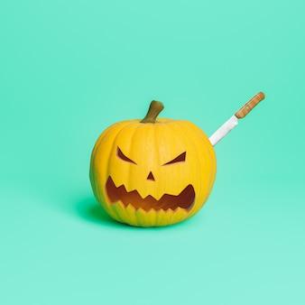 Тыква на хэллоуин с застрявшим в ней ножом