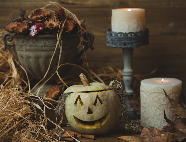 Halloween pumpkin with decorative candles