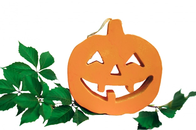 Halloween pumpkin with green leaves and white background.