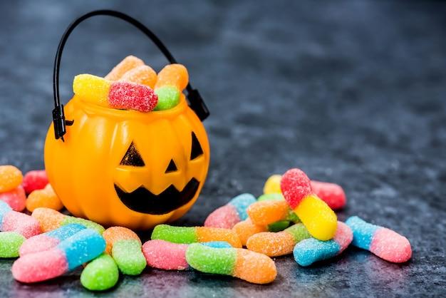 Halloween pumpkin with sweet candy