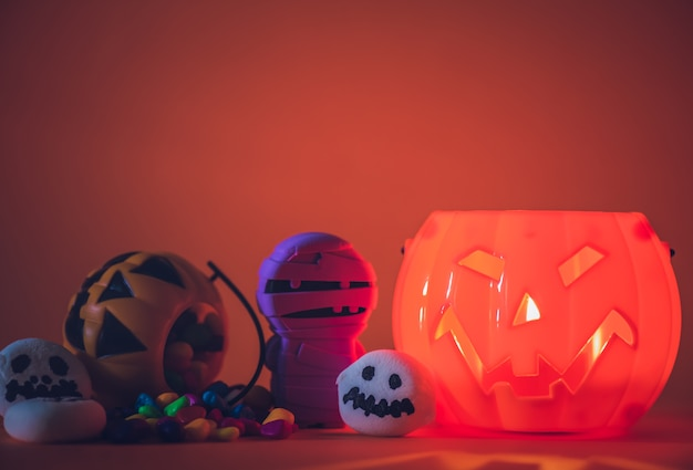 Halloween pumpkin with sweets candies and ghost marshmallow
