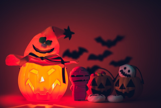 Halloween pumpkin with sweets candies and ghost marshmallow.