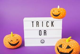 Halloween pumpkins and plastic board