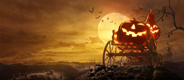 Halloween pumpkins on farm wagon going through stretched road grave