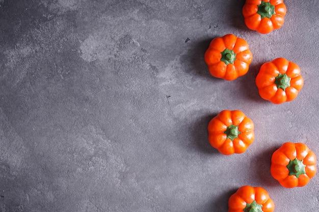 Halloween pumpkins on a gray table. flat lay.