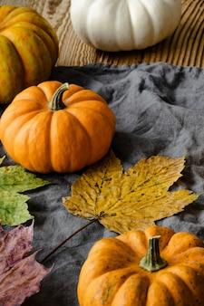Halloween pumpkins jack o' lantern with maple leaves