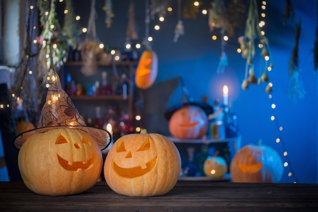 Halloween pumpkins on old wooden table on background halloween decorations