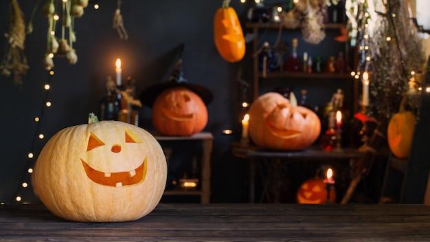 Halloween pumpkins on old wooden table on surface