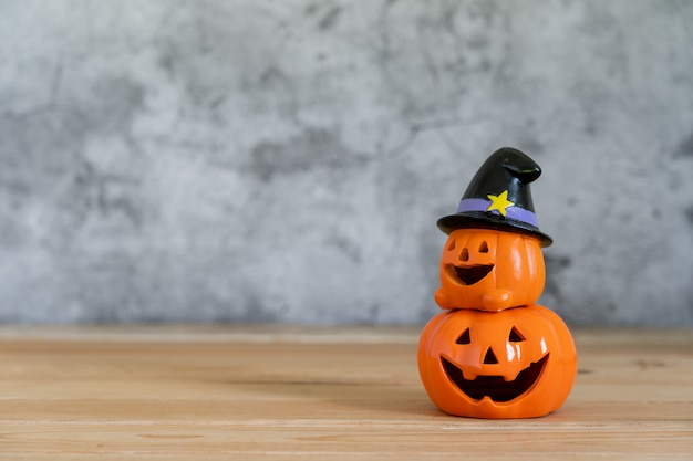 Halloween pumpkins toys on wall background