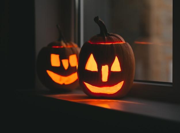 Halloween pumpkins at windows with bokeh.