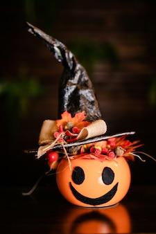 Halloween pumpkins with black witch hat