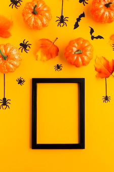 Halloween pumpkins with leaves and mock-up frame