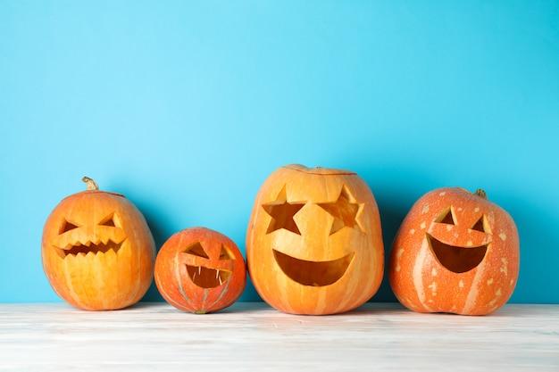 Halloween pumpkins on wooden table. halloween concept