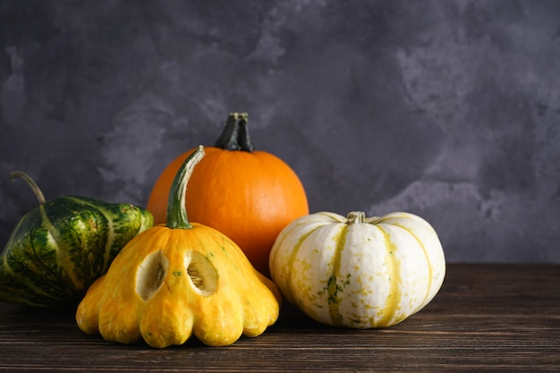 Halloween pumpkins on wooden table, place for text. halloween composition.