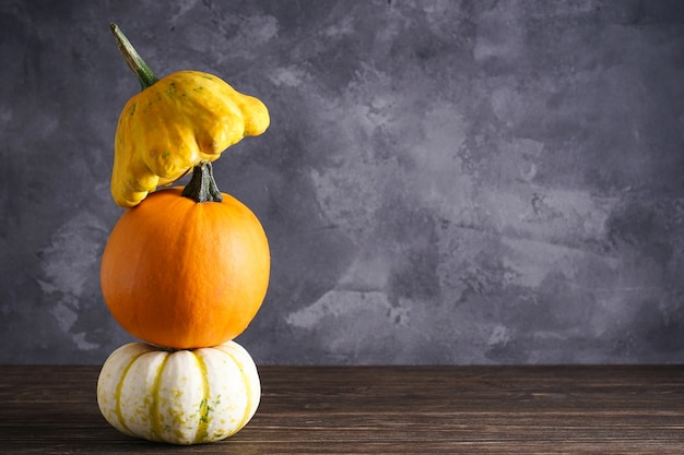 Halloween pumpkins on wooden table. place for text.