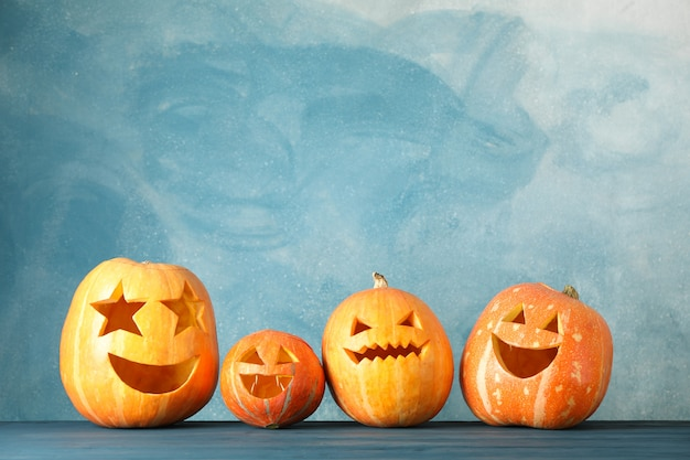 Halloween pumpkins on wooden table. space for text