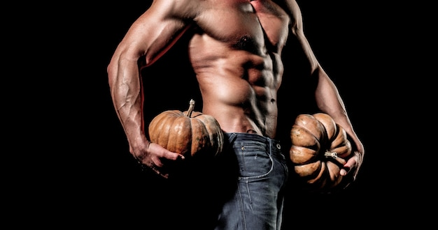 Halloween sale and shopping fashion guy with sexy naked torso hold pumpkin