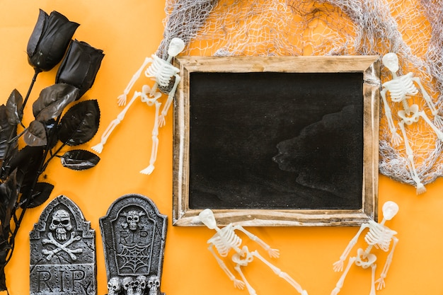 Halloween slate composition with black roses