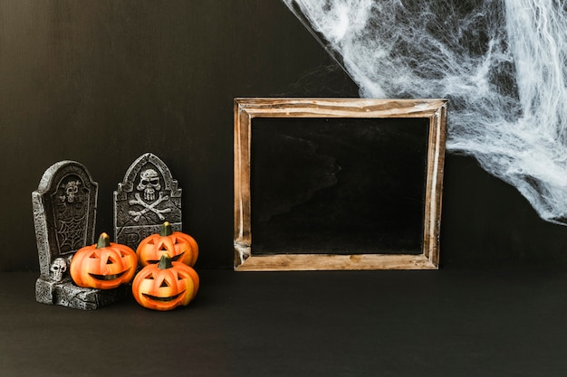 Halloween slate composition with cobweb
