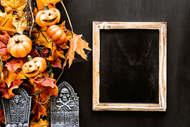 Halloween slate composition with leaves and tombstone