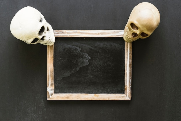 Halloween slate composition with two skulls