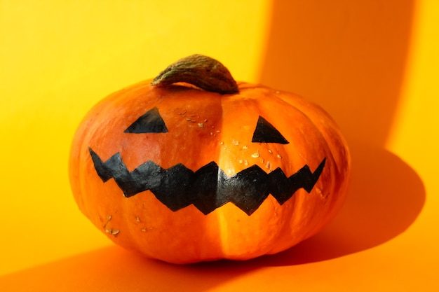 Halloween smile jack pumpkin  isolated on orange
