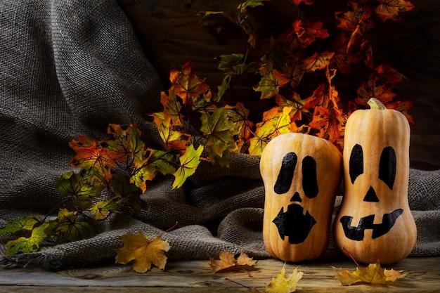 Halloween smiling butternut squash on dark rustic