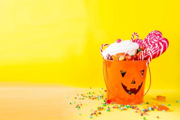 Halloween sweets on yellow
