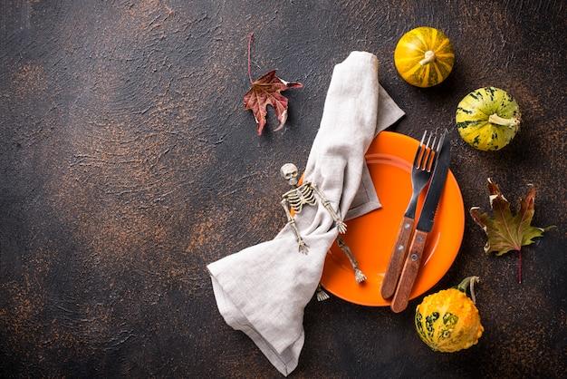 Halloween table setting with pumpkin