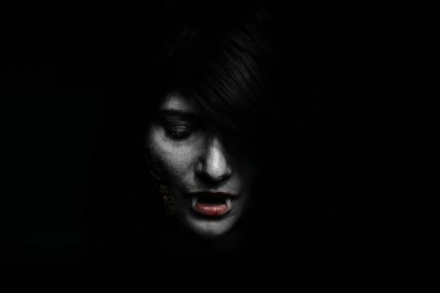 Halloween vampire beautiful woman over black