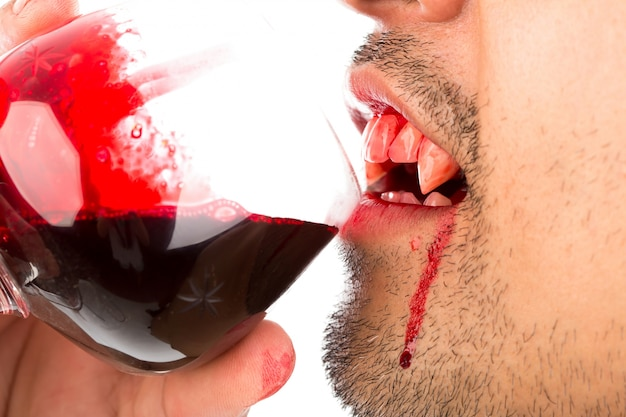 Halloween vampire drink blood on white background