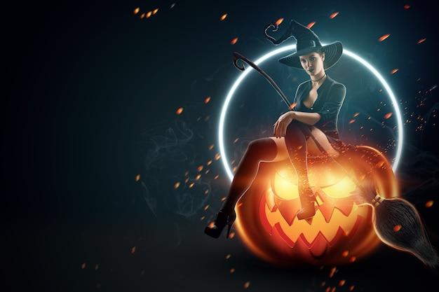 Девушка ведьмы хеллоуина сидит на тыкве. красивая молодая женщина в шляпе ведьмы с метлой. час