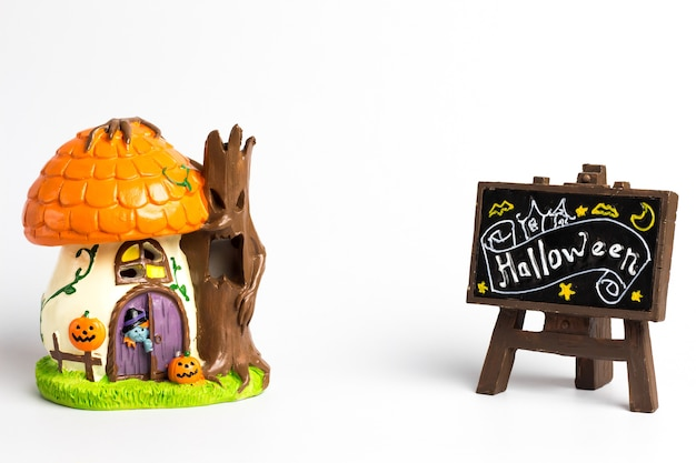 Halloween witch house and brown label with a halloween text.