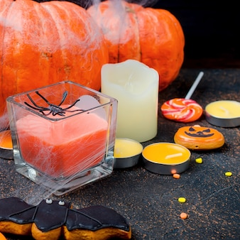 Halloween with gingerbread, pumpkins and candles