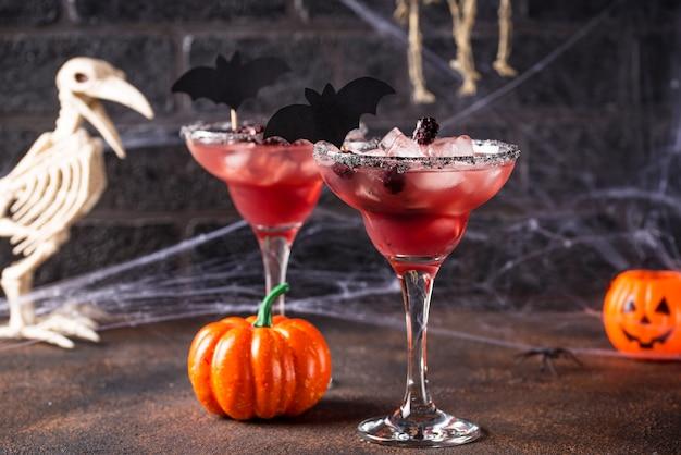 Halloweens spooky drink with blackberry