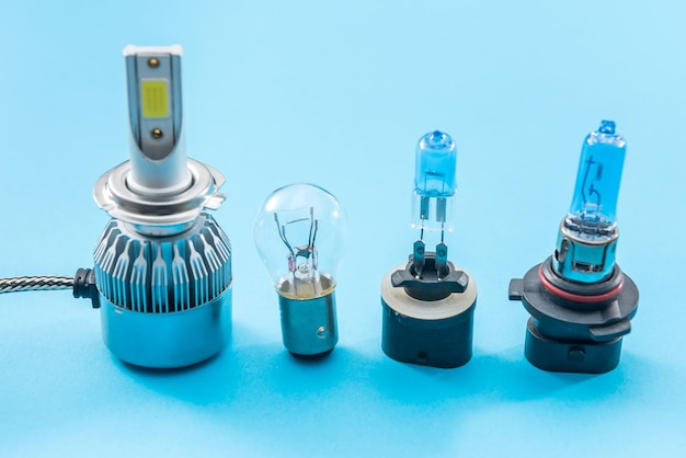 Halogen diod car bulb isolated on color background for repair. modent equipment for headlight. lamp technology
