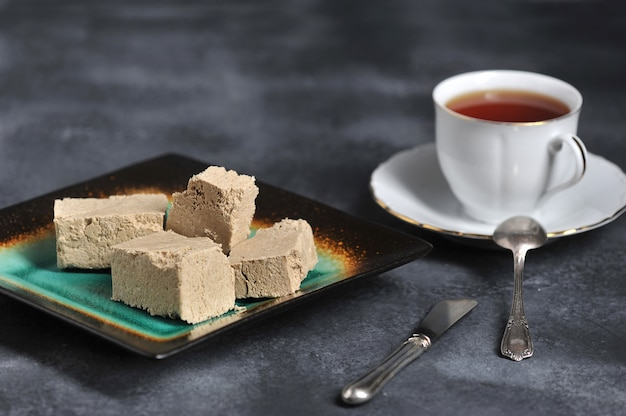Halva chopped into slices on a plate