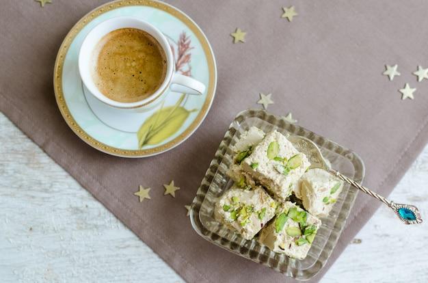Halva pistachio and cup of coffee
