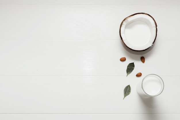 Halved coconut on white background with copy space