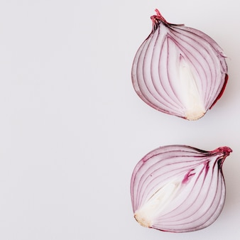 Halved onion isolated on white background