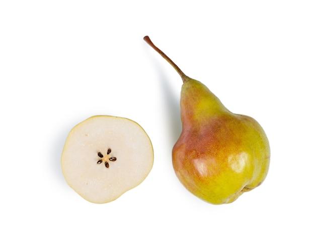 Halved pear cut through the cross section alongside a tasty pear
